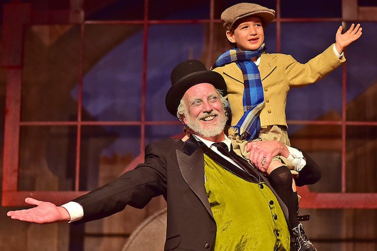 Scrooge Tiny Tim 2017: Ebenezer Scrooge (Jeff Stockberger), left, lifts Tiny Tim (Ashton Curry) in Beef & Boards Dinner Theatre's one-hour production of A Christmas Carol. The Charles Dickens favorite is now on stage for a limited run through Dec. 22. For reservations, call the box office at 317.872.9664. For details and complete show schedule visit beefandboards.com.